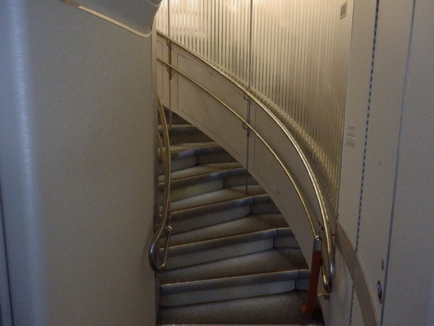 STAIRS FROM ECONOMY TO BUSINESS CLASS AT REAR OF THE PLANE