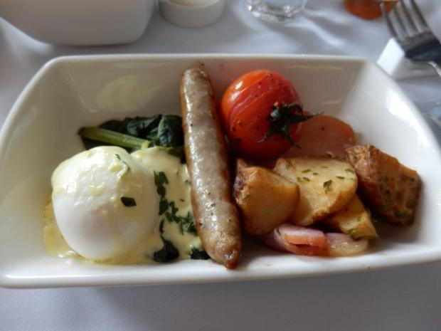 BREAKFAST: POACHED EGG, SAUSAGE, SPINACH, BACON, POTATOES, AND TOMATO