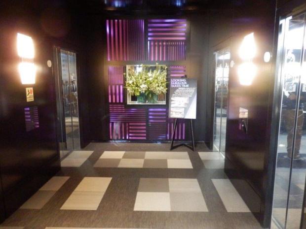 LOBBY: ELEVATORS TO HIGHER FLOORS