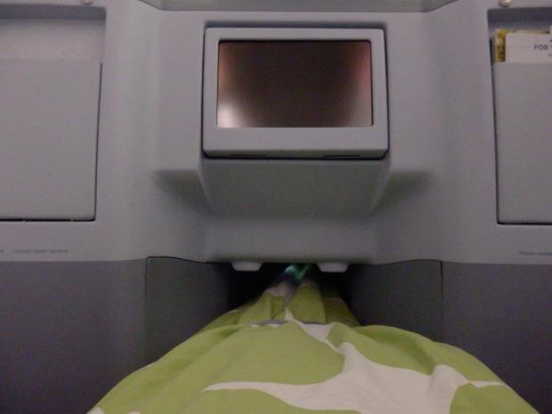 BUSINESS CLASS SEAT 6A IN LIE FLAT POSITION