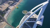 LAND WITH A HELICOPTER ON TOP DUBAI'S BURJ AL ARAB HOTEL (UAE)